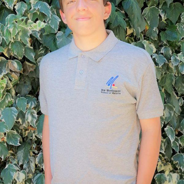 Boy with a grey polo short as school uniform